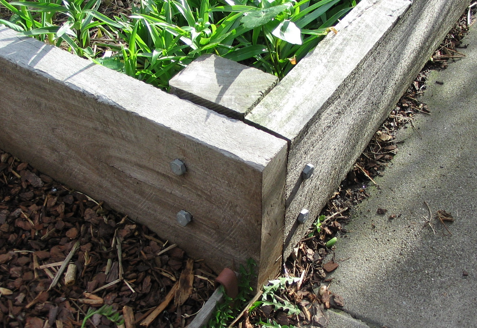 Railway Sleepers Attacked To A Corner Post With Coach Screws